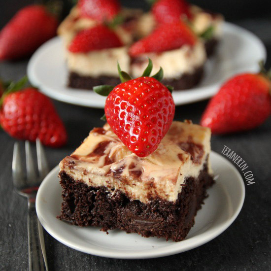 These fudgy strawberry cheesecake brownies are made healthier with Greek yogurt and 100% whole grains!