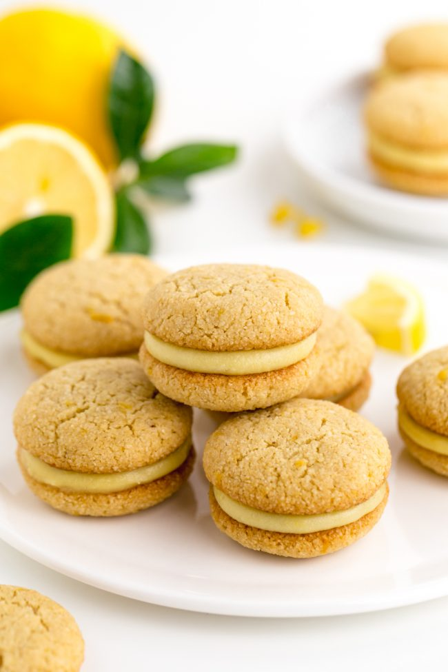 Lemon curd is sandwiched between soft and chewy paleo lemon cookies in this dairy-free treat!