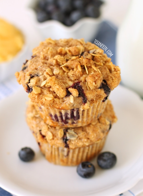 These blueberry muffins are stuffed with lemon curd and are made healthier with whole grains!