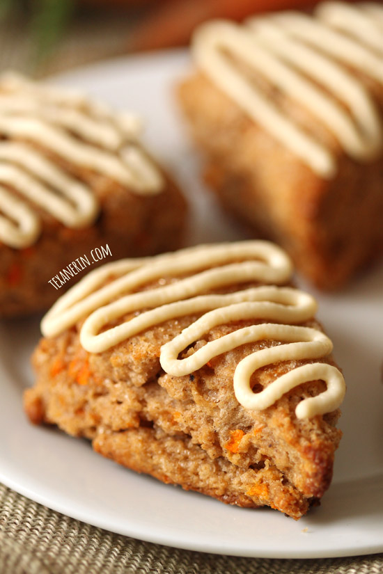 These healthier carrot cake scones are made with 100% whole grains, less sugar and maple sweetened cream cheese frosting!