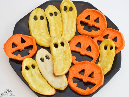 Roasted sweet potato jack-o-lantern face and ghosts