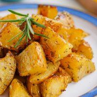 greek potatoes on plate close-up