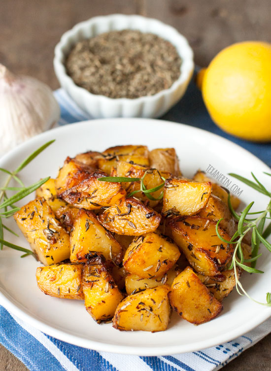 Greek Style Roasted Potatoes are crisp on the outside and have creamy centers. Naturally vegan and gluten-free.