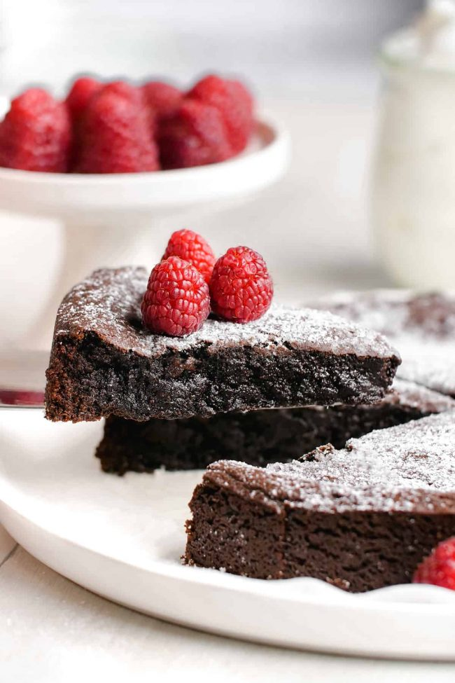 This kladdkaka, also known as Swedish chocolate sticky cake, is amazingly gooey, delicious and only calls for 8 simple ingredients. This recipe includes a traditional option as well as a gluten-free, dairy-free and vegan version.