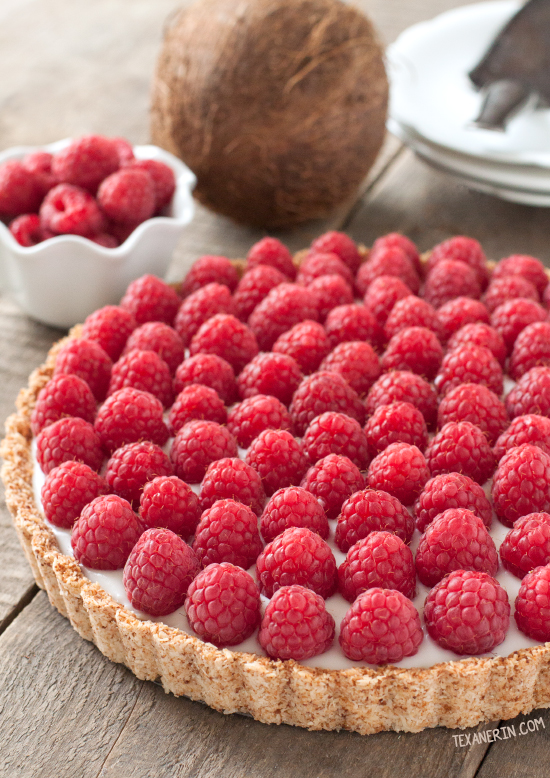 This raspberry coconut tart has a simple press-in coconut crust and coconut pudding filling! {vegan, gluten-free, and dairy-free}