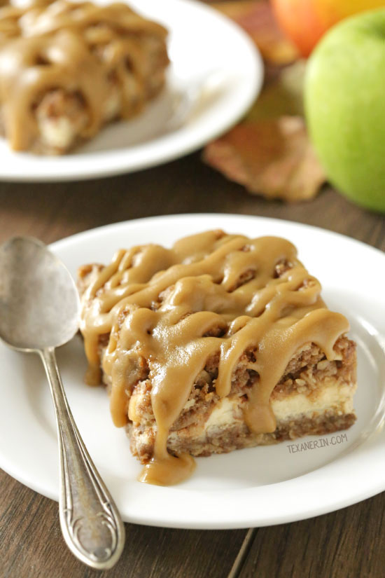 These caramel apple cheesecake bars feature an oatmeal cookie-like crust and topping with a simple caramel glaze! They're oat-based making them gluten-free as well as 100% whole grain.