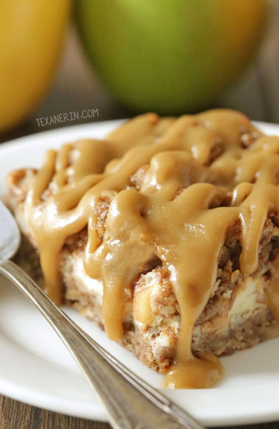 These healthier caramel apple cheesecake bars feature an oatmeal cookie-like crust and topping with a simple and delicious caramel glaze! They're oat-based making them gluten-free and 100% whole grain.