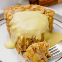 Vegan custard on a slice of Swedish apple pie