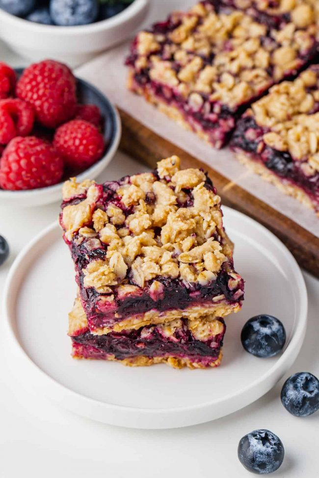 These berry bars have a thick layer of blueberries mixed with berry jam nestled between a crumb-like crust and topping! Can be made with all-purpose, gluten-free or whole wheat flour. Can also be made vegan and dairy-free.