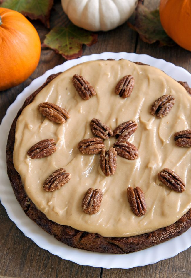 This paleo pumpkin cake is super moist and easy to make! Topped off with maple cream frosting and maple candied pecans.