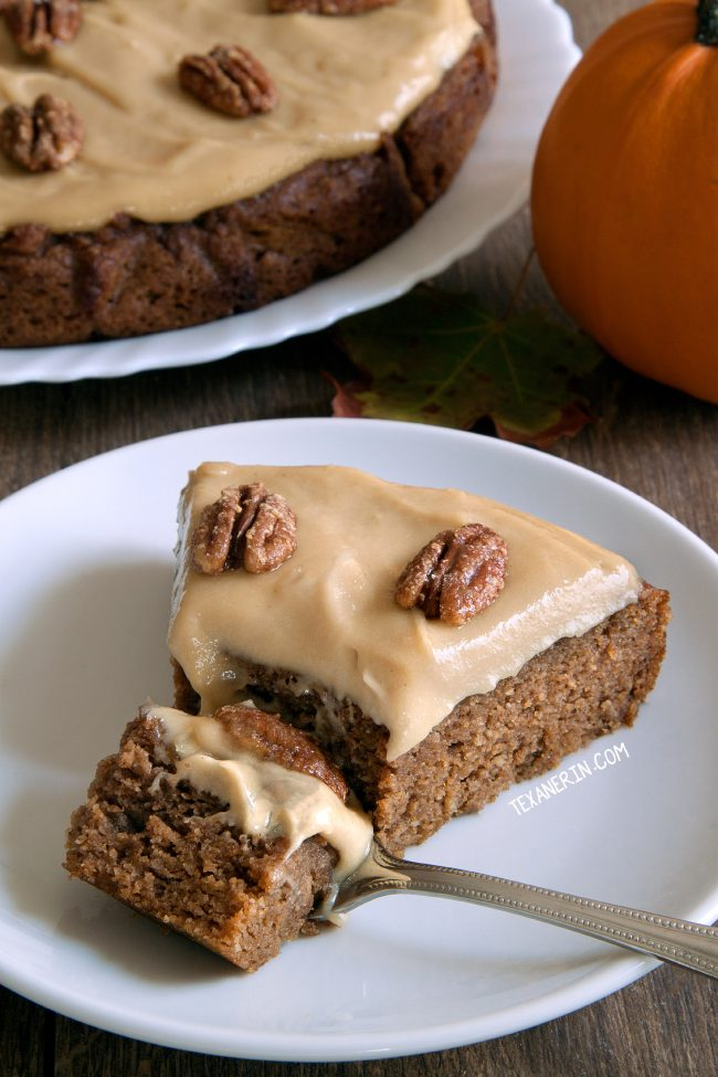 This paleo pumpkin cake is nice and moist and super easy to make! Topped off with maple cream frosting and maple candied pecans.