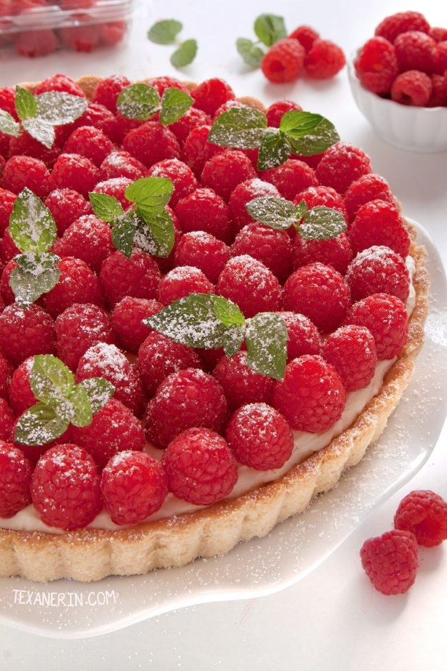 This raspberry almond tart has a sugar cookie-like crust and almond cream cheese filling. Can be made with gluten-free, whole grain and all-purpose flours.