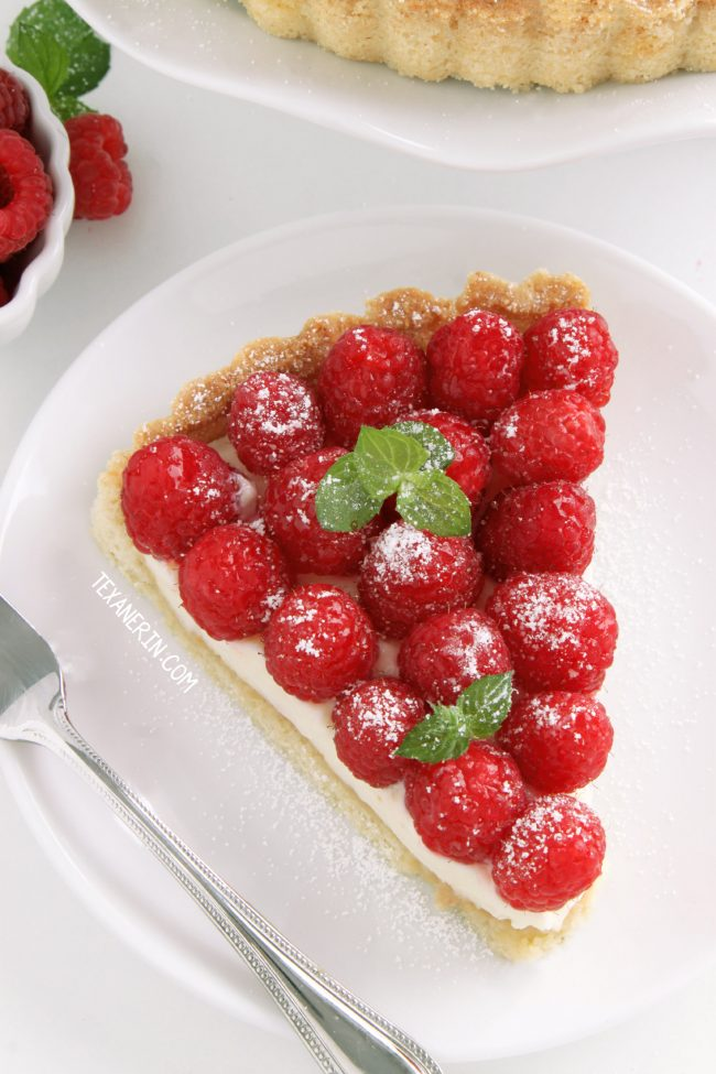 This super delicious raspberry almond tart has a sugar cookie-like crust and almond cream cheese filling. Can be made with gluten-free, whole grain and all-purpose flours.