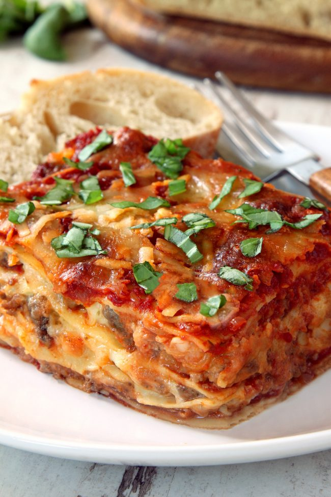 This classic homemade lasagna has homemade red wine sauce, a super creamy cheese filling and can be made with gluten-free, whole wheat or with regular noodles.