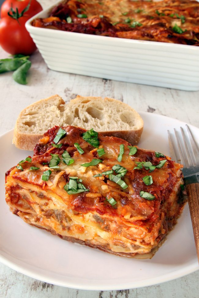 This classic homemade lasagna has homemade red wine sauce, a super creamy cheese filling and can be made with gluten-free, whole wheat or traditional noodles.