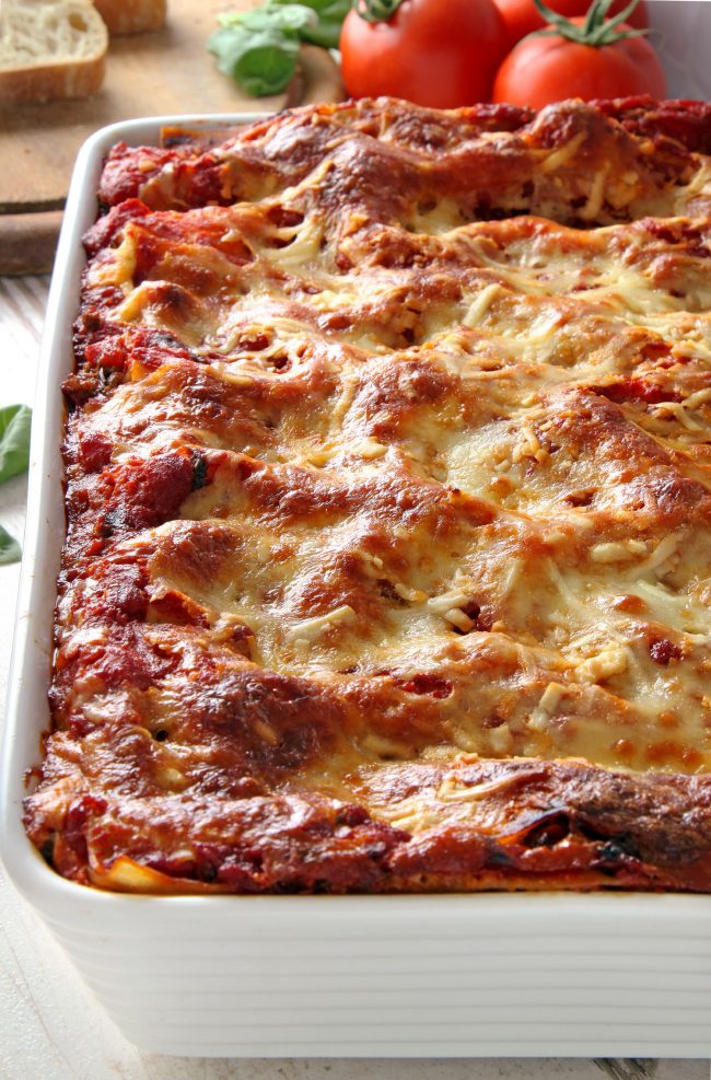This classic homemade lasagna has homemade red wine sauce, an amazingly creamy cheese filling and can be made with gluten-free, whole wheat or regular noodles.