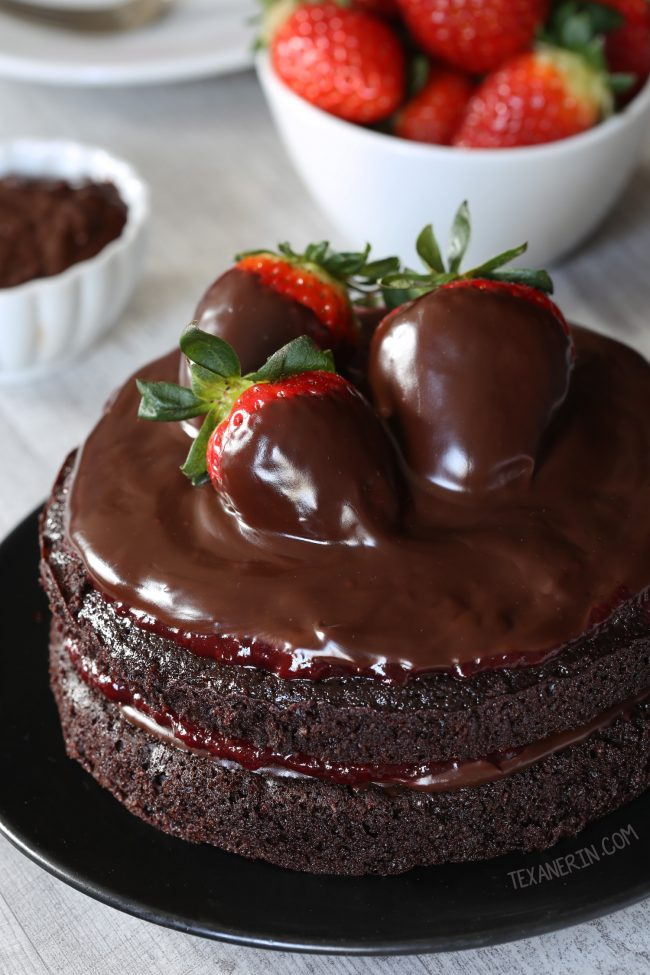 This paleo chocolate strawberry cake has a great texture, chocolate fudge frosting and strawberry filling. With whole wheat and all-purpose flour options.