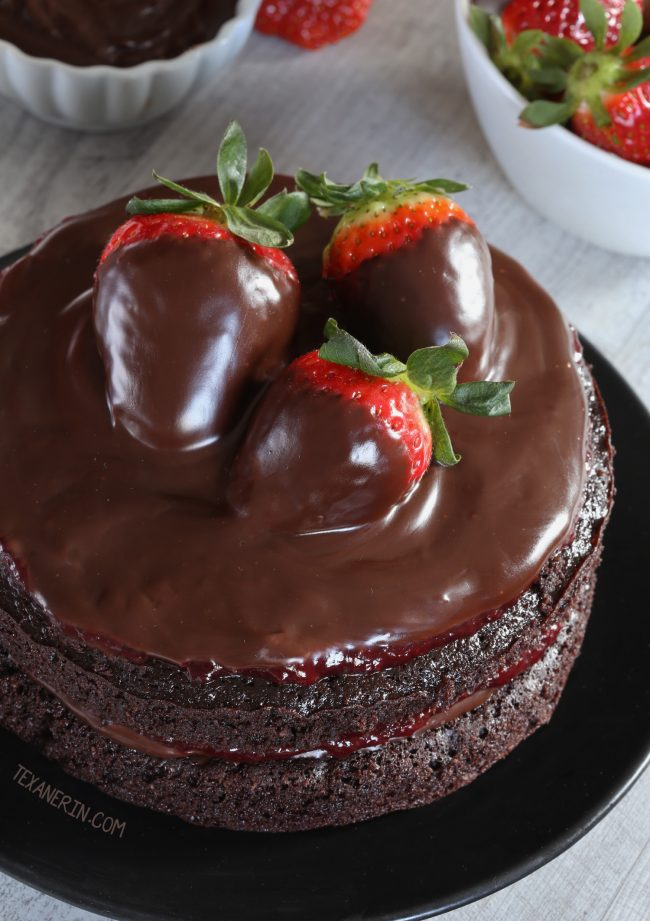 This moist paleo chocolate strawberry cake has a great texture, chocolate fudge frosting and strawberry filling. With whole wheat and all-purpose flour options!