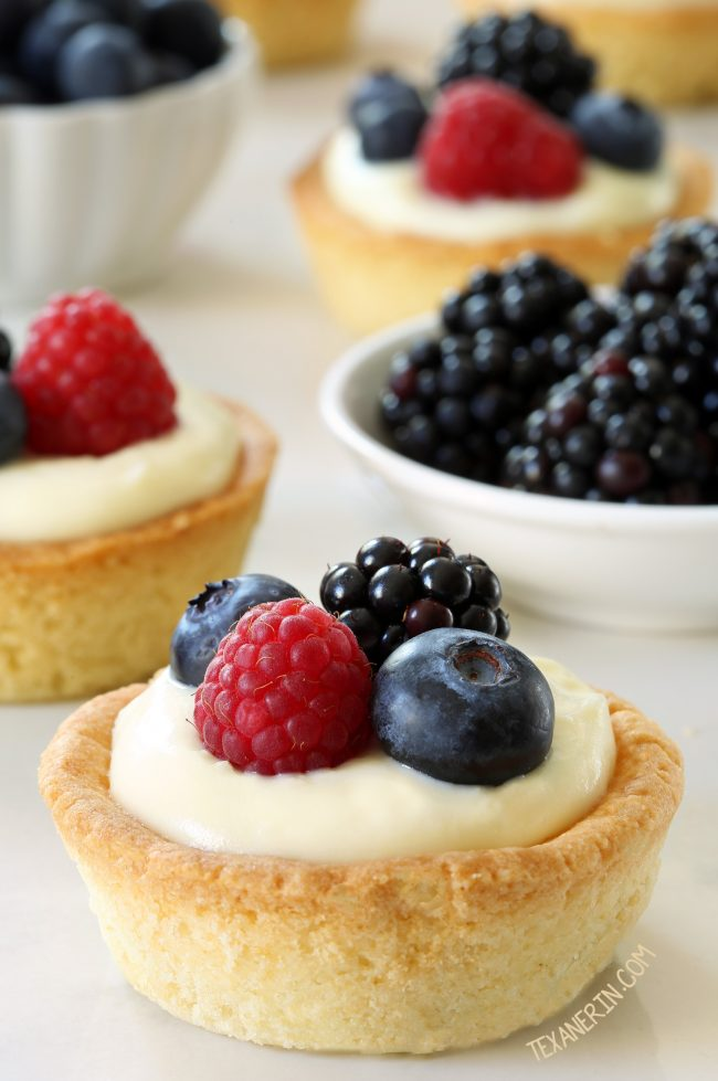 These cheesecake cookie cups have a sugar cookie crust and a delicious white chocolate cream cheese filling. Can be made with gluten-free, whole wheat or all-purpose flour.