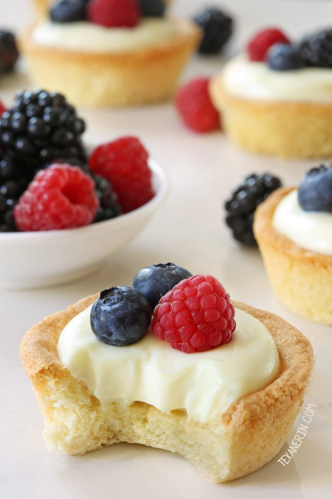 These cheesecake cookie cups have a sugar cookie crust and a delicious white chocolate cream cheese filling. Can be made with gluten-free, whole wheat and all-purpose flour.