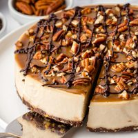 This paleo vegan turtle cheesecake is rich, creamy and won't leave you missing the dairy! It's also no-bake and perfect for Christmas.