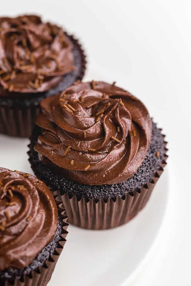 These amazing gluten-free chocolate cupcakes are incredibly moist and just as delicious as traditional cupcakes! With vegan and dairy-free options.