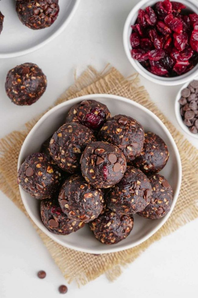 These bliss balls are loaded with chocolate, are no-bake and easy to make gluten-free and vegan. They only take 6 ingredients and 5 minutes to make! Your family is going to love these chocolate bliss balls.